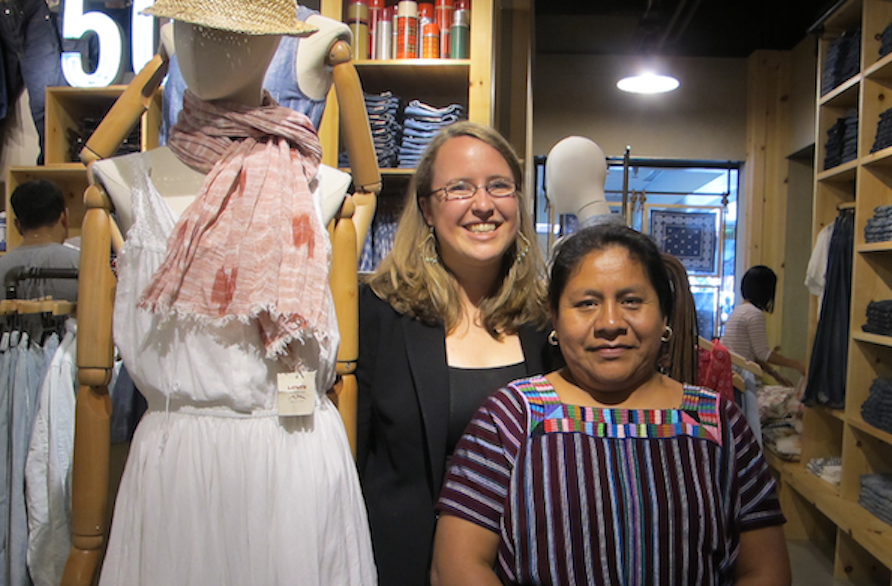 At top, Delia on a visit to Levi Strauss & Co.'s San Francisco headquarters. Above, Delia and Mercado Global Executive Director Ruth DeGolia at the Levi's Plaza Store in San Francisco, shown next to a Mercado Global scarf.